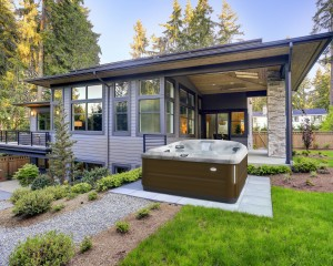 Modern installation of the J-485 Jacuzzi Hot Tub in a backyard.
