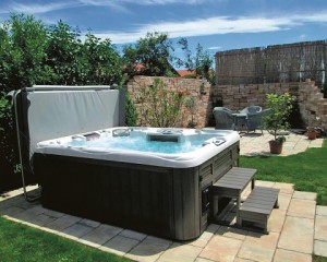 Outdoor hot tub with a hot tub cover.