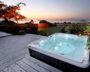 Outdoor hot tub installed on a deck foundation.