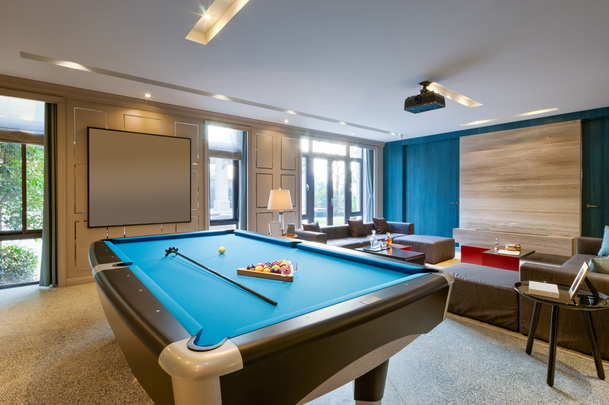 Pool table in modern game room.