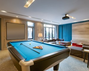 Pool table in modern game room.