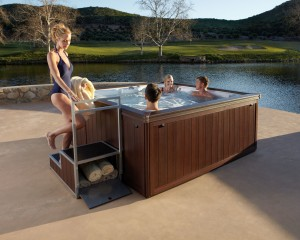 Family relaxing in the hot tub outside.